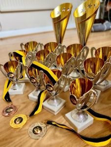 Centre Stage Virtual Performing Arts Festival trophies and medals